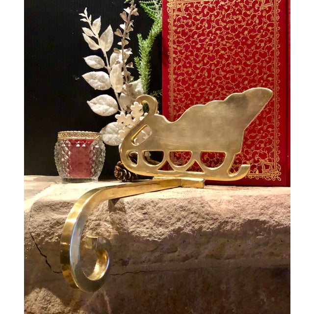 This is for one Solid Brass vintage stocking hanger, mantle Christmas hook, that is a sleigh. This piece has a long hook....