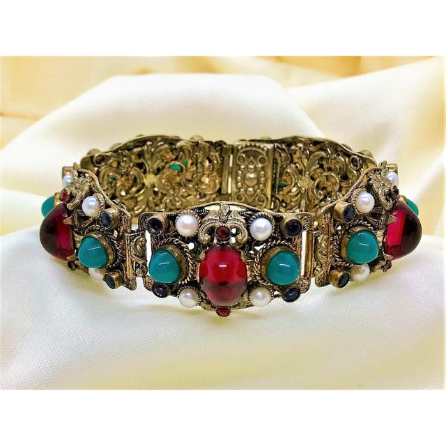 Circa 1940s ornately designed, Austro Hungarian style, gold tone metal bracelet. It is bezel and prong set with cultured...