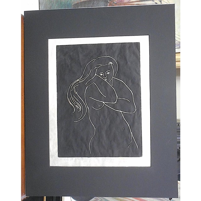 This pencil signed and numbered limited edition print by Marian McDaniel depicts a nude woman. It is signed by the artist,...