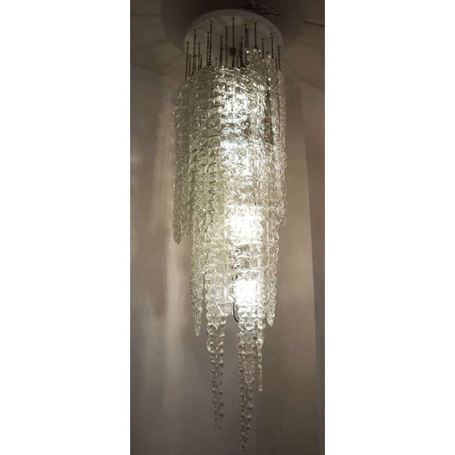 "In the 50's Venini designed and made the "" Alga"" chandeliers featuring textured glasses of different lengths. A close look..."