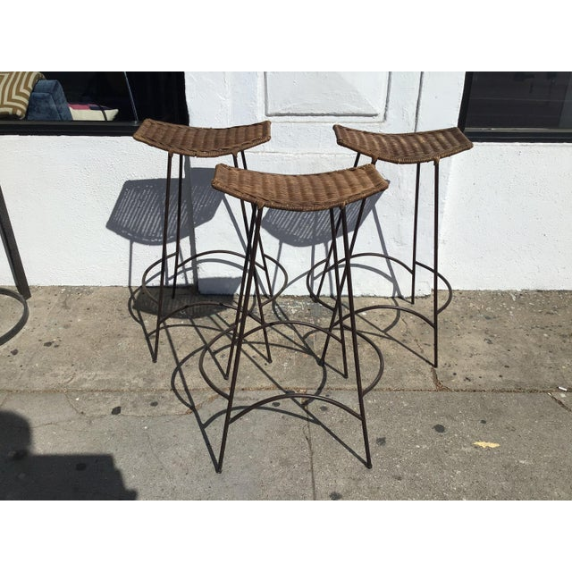 Set Of 3 60s Rattan + Iron Barstools by Arthur Umanoff, a notable American mid-century designer. They work with any design...