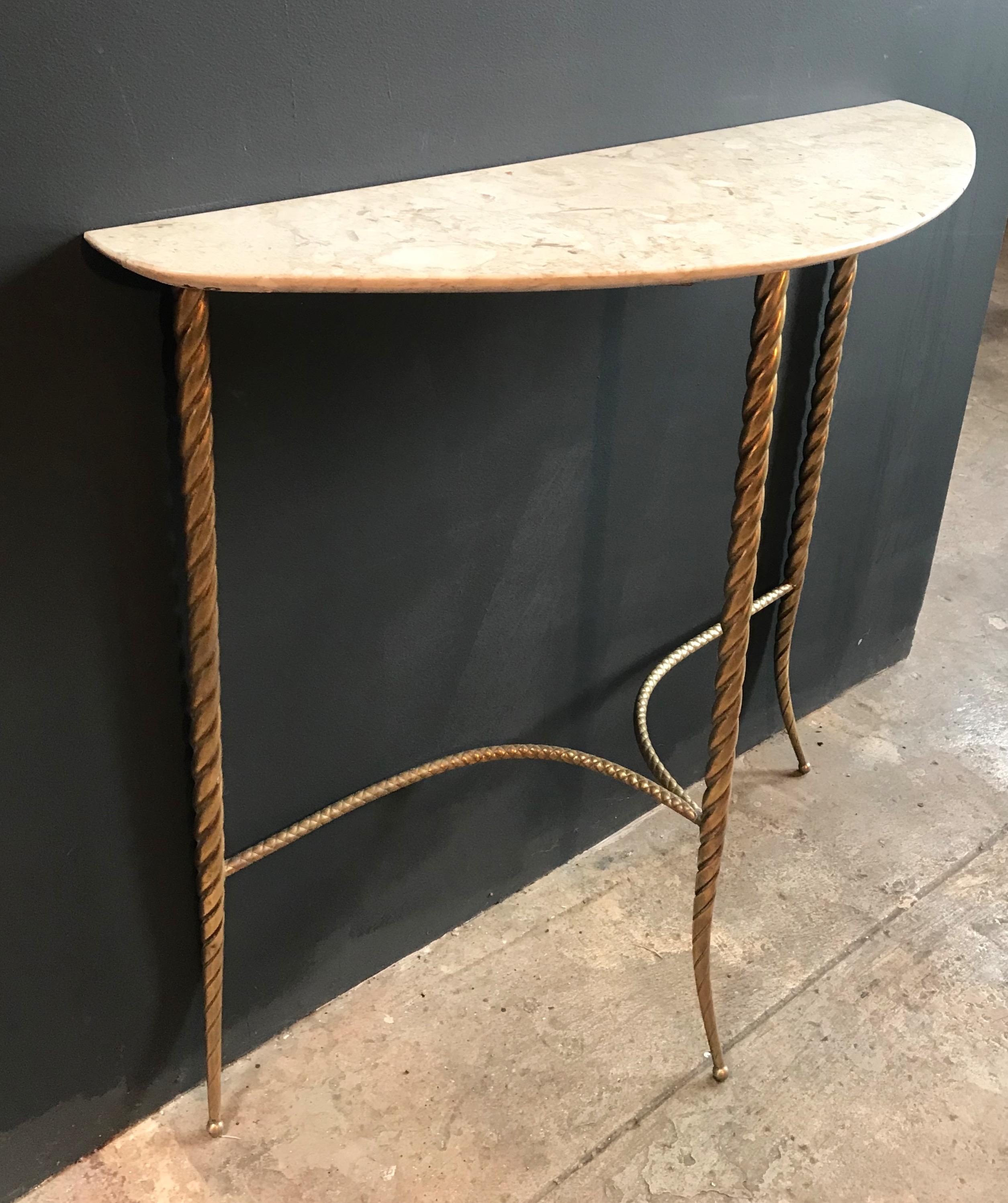 This Elegant And Tiny Console Table Stands On Three Legs In Full Brass And  A Shaped