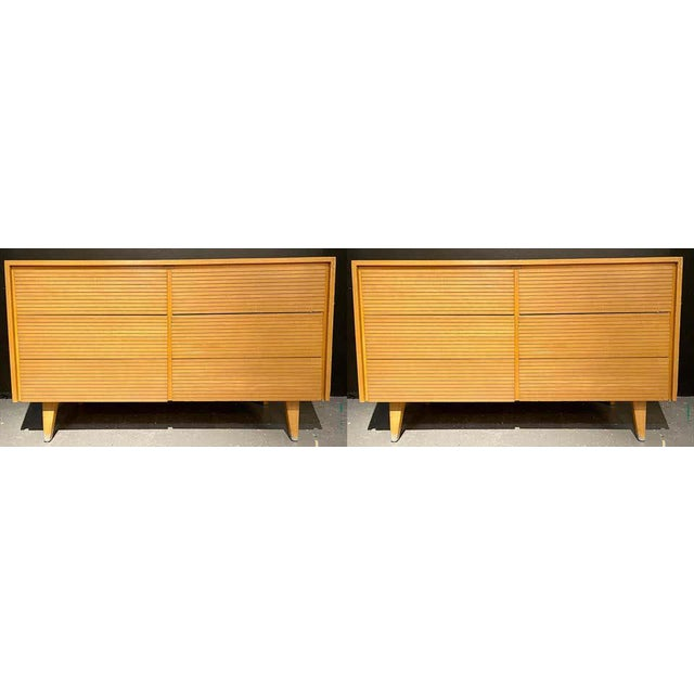 Pair of six-drawer Mid-Century Modern chests, dressers or nightstand commodes. Each in a fine teak finish having three by...