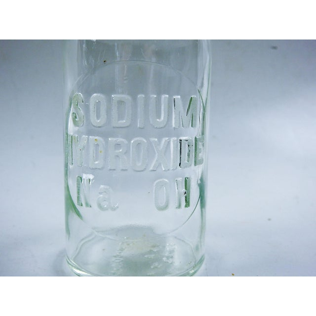 Vintage new old stock ( never used) embossed Sodium Hydroxide bottle. Lettering is frosted.