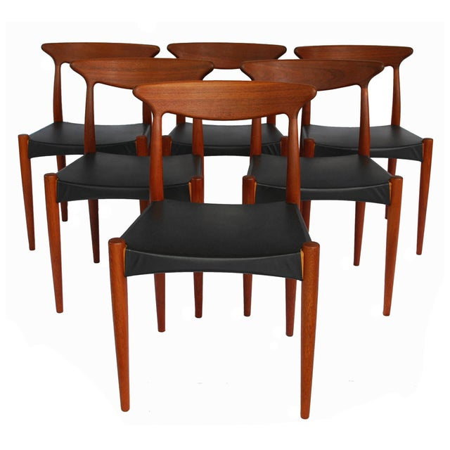 Set of six 1960's dining chairs designed by Arne Hovmand-Olsen and produced by Mogens Kold, Denmark. These handsome mid-...