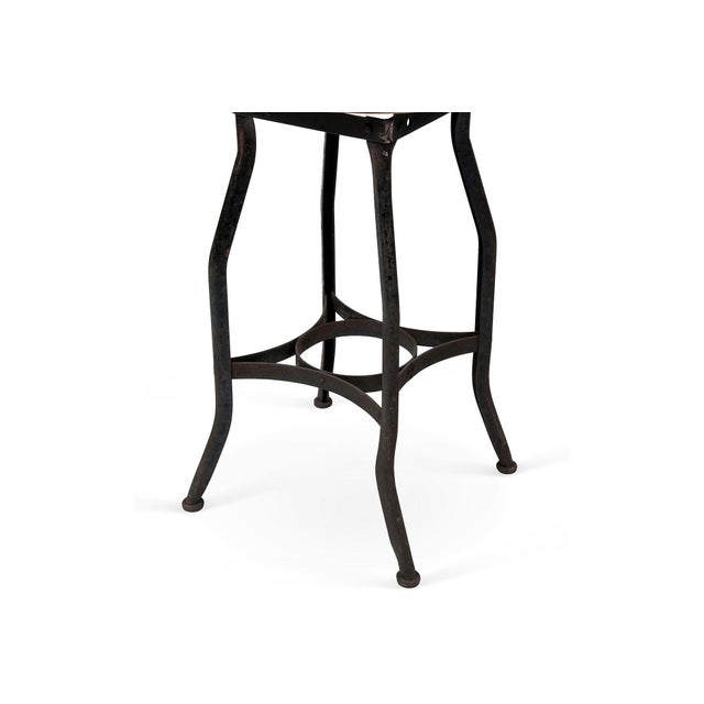 Get comfortable with the industrial look whilst perched upon this edgy stool, featuring a metal base and bleached wood...