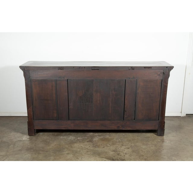 French Louis Philippe enfilade buffet of solid walnut with a bookmatched walnut front, having three doucine drawers over...