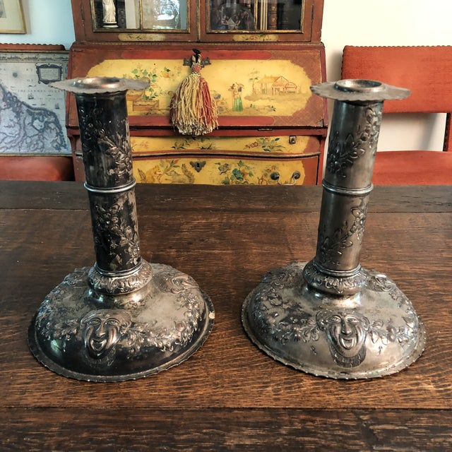 Pair of 18th century silver over copper Swedish repousse candle holders. Embossed fruit, flower, garland and mask motif....