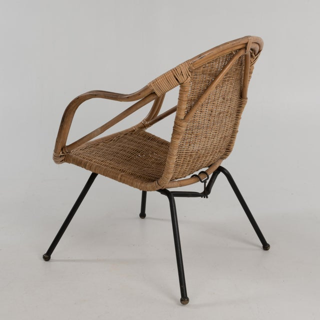Mid-Century modern rattan & sculpted bamboo hoop chair with iron legs ending on brass ball feet. Great Mid-Century...