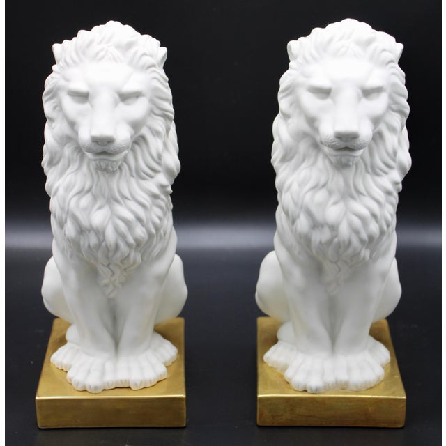 A superb pair of Mid-20th Century Italian Mottahedeh Ceramic Lions on Gold Bases. Excellent mantle decorations or...