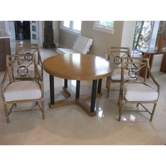 This listing consist of a very nice round ding room table and chairs by mcguire. It comes with a set of 4 target chairs...