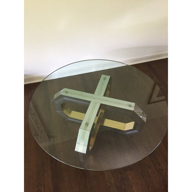 Gorgeous Paul Evans style geometric coffee table clad in polished brass, and bushed and polished stainless panels. Overall...