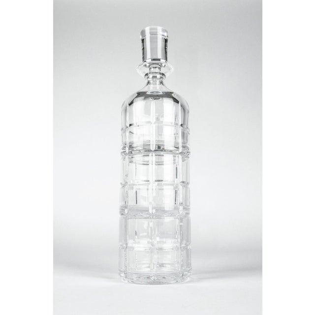 Cut crystal bottle drinks decanter that can convert into two whiskey / scotch glasses . The decanter is in excellent...