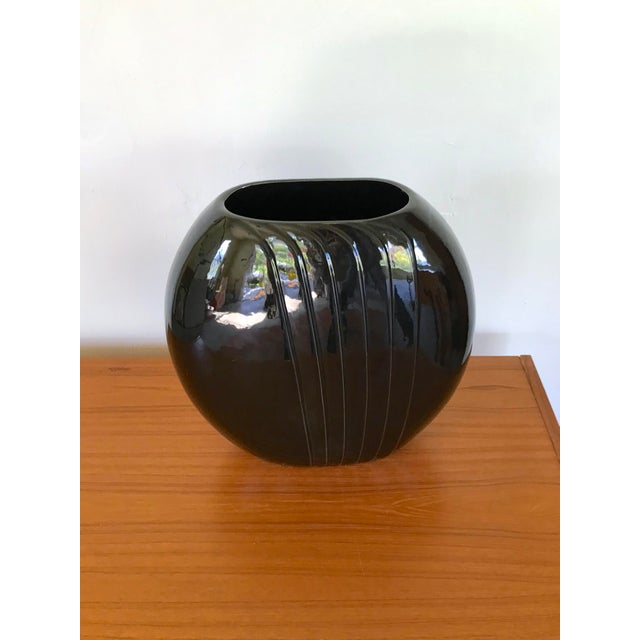 Large black vase with verticle pleated detail marked 1987 on the bottom. Excellent statement piece!
