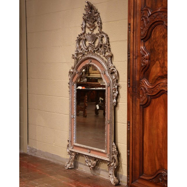 This beautiful Rococo style silver gilt mirror was crafted in Italy, circa 1940. The baroque wall piece features a large...