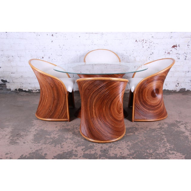 Offering an exceptional bamboo dining set by renowned designer Henry Olko for Willow and Reed, circa 1978. The set...