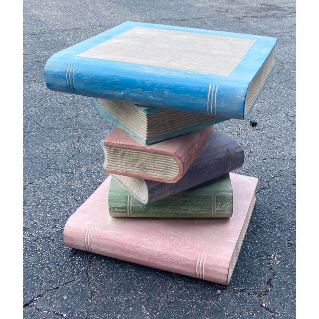 Vintage stack is hand carved wooden books. Perfect as an end table or as a last minute drinks table. Charming and...