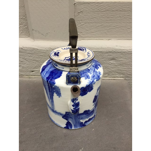 Beautiful hand-painted, paneled ceramic teapot from China with beautiful lid handpainted characters brass handle and trim...