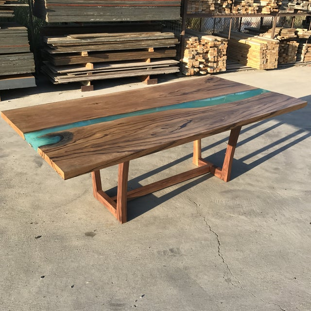 Resin river table made by Dog and Pig Furniture. Title: Panama Table. Material: Canary wood & Resin Base: Walnut About:...