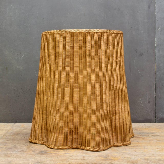 Vintage midcentury thin wicker woven table with some wear to top raised edge. Measures: Top dia 19.75, base dia 27.25 x H...