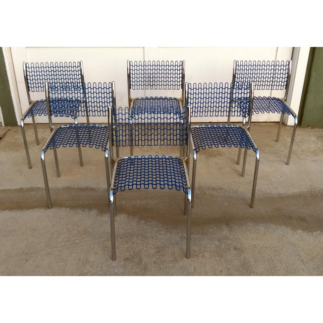 Set of six tubular chrome-plated steel frame with royal blue plastic-coated grided sheet for seat and back. Frame composed...