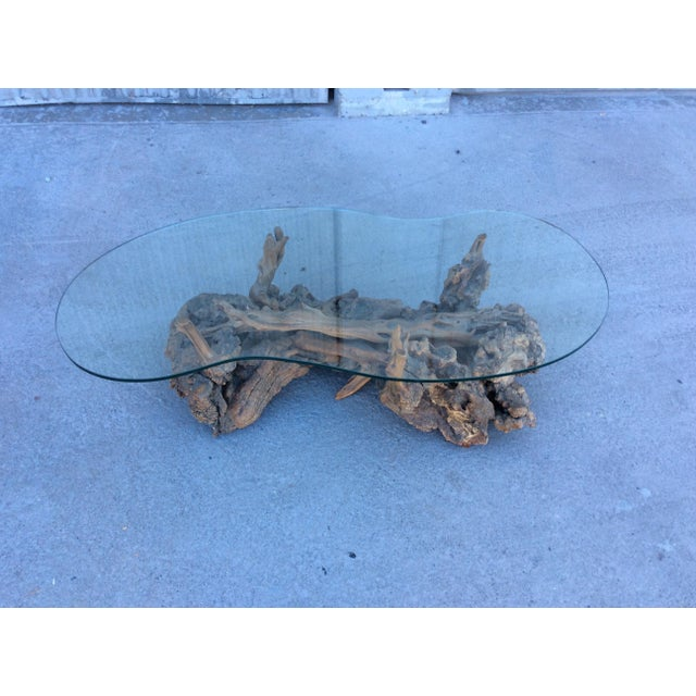 Definitely a throw-back to the 60's! Glass top that's currently on it has a chip - as shown in one of the photos. We...