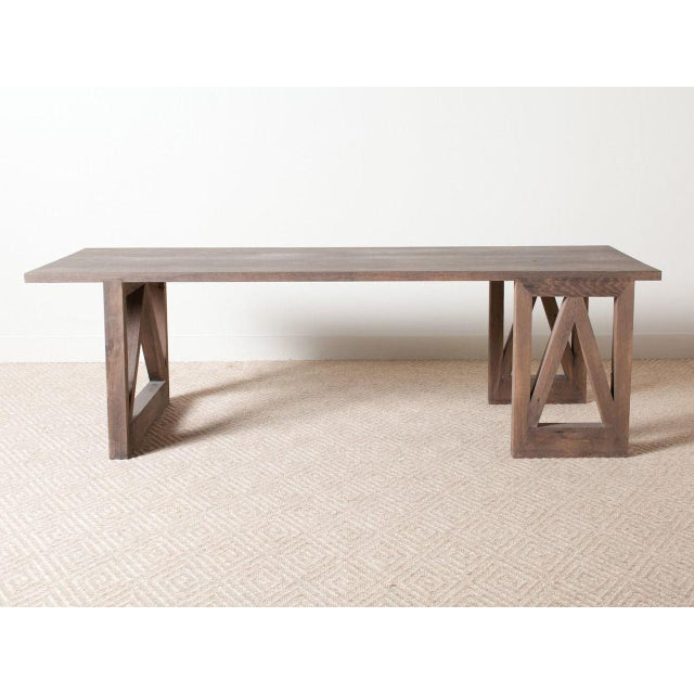 Rectangular dining table hand, crafted from reclaimed oak with stained and sealed finish. Contemporary and made in the 2010s.