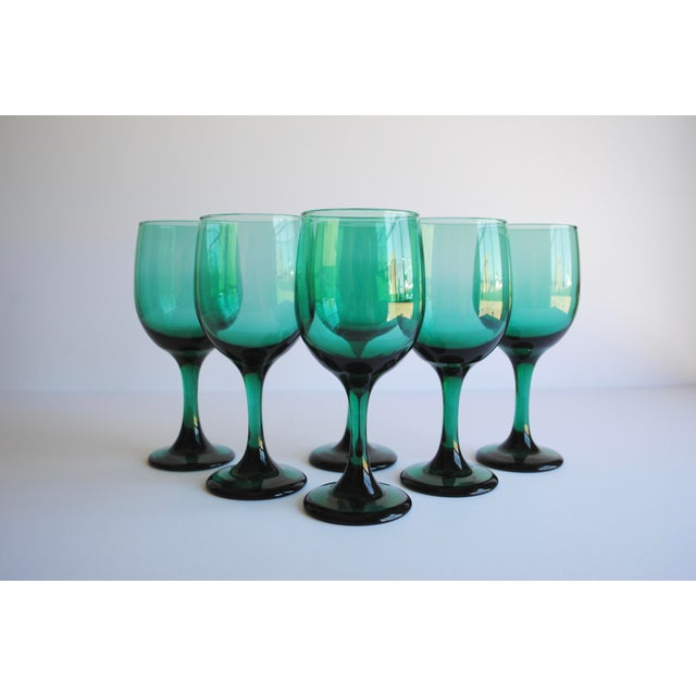 Set of six dark green wine glasses. Beautiful addition to your bar, table and parties!
