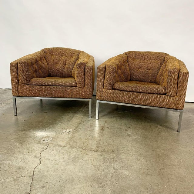 Pair of vintage modern club chairs designed by Jules Heumann for Metropolitan Furniture. These comfortable chairs have...