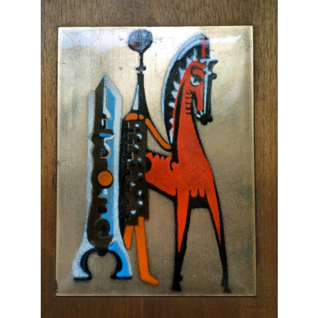 A fun and vibrant art piece from the Mid-Century Modern era. This piece is copper with enameling, set on a walnut backing....