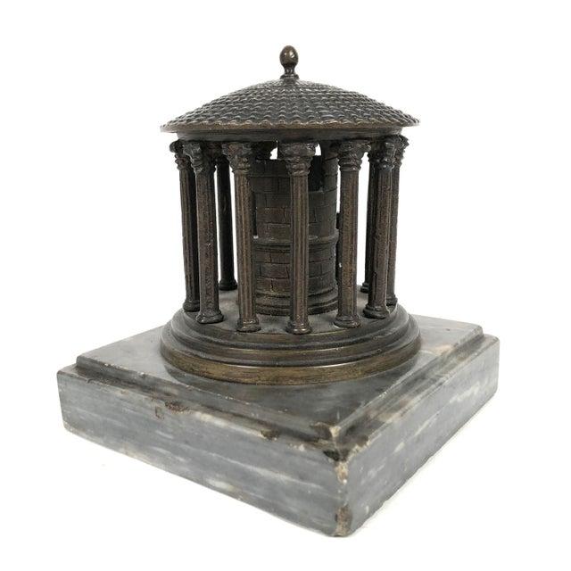 A 19th century Grand Tour neoclassical bronze architectural model of the Temple of Vesta, Rome, circa 1875, on a square...