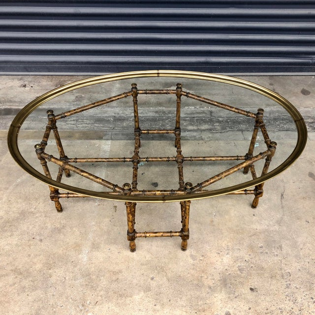 Vintage faux bamboo coffee table with brass tray top. Mottled tortoise shell finish faux bamboo base with classic simple...