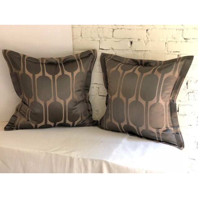 "Pair of 24"" square flange edge pillows in gray and taupe. The pattern is Black Parrot by Jim Thompson. The pillows have a..."