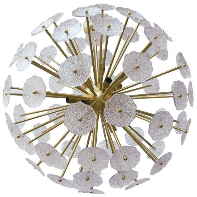 Italian Sputnik chandelier shown in clear molded Murano glass with textured bubbles on unlacquered brass frame designed by...