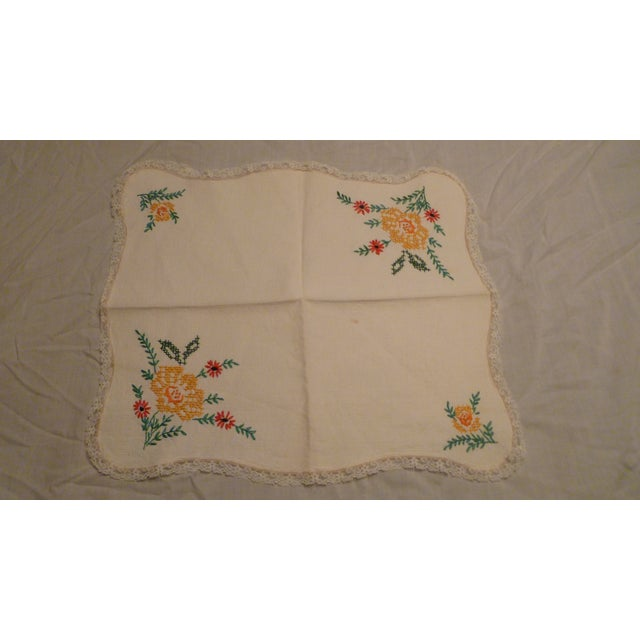 This is a lovely handmade embroidered linen. Vibrant sewn colors and quality scalloped rolling edging. Edged with lace....