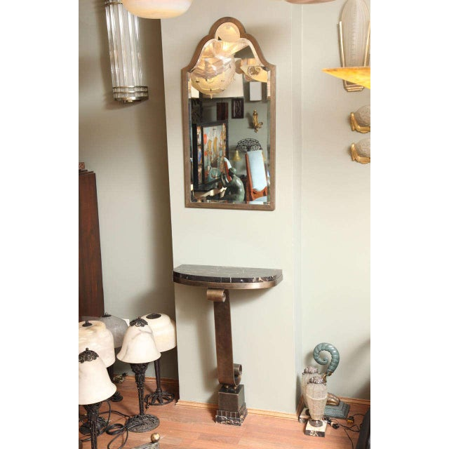 A French Art Deco console table attributed to Raymond Subes, with scrolling leg and portoro gold marble top, together with...