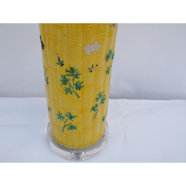 Stunning vibrant yellow antique Chinese bamboo form vase, custom mounted as a lamp. Lamp sits atop a raised lucite base....