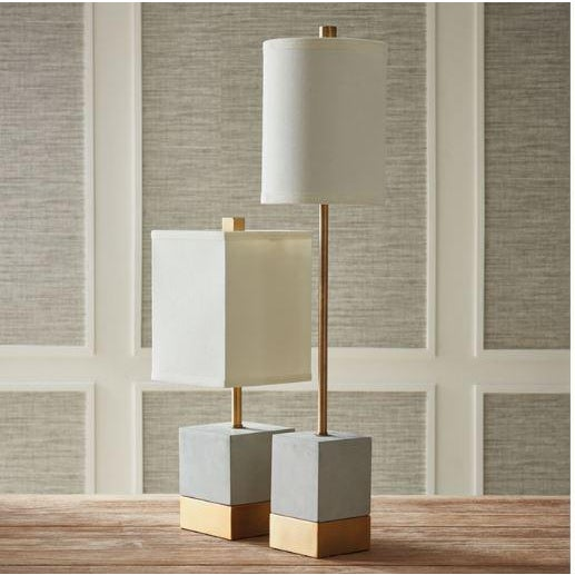 An unexpected mix of cement and brass accents make this lamp a stand out piece. The tall, narrow base and tailored shade...