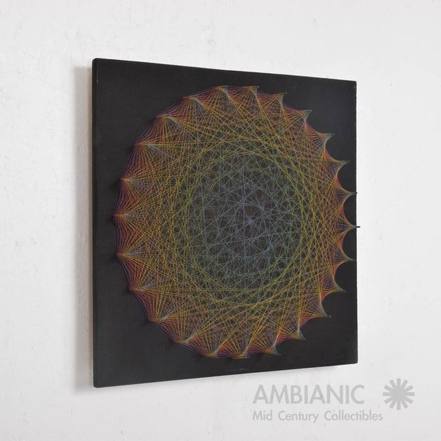 For your consideration a beautiful Mid-Century period symmography wall art, made of colored cotton strings. Mounted in...