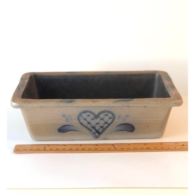"""Fantastic """"Rowe Pottery Works,"""" Cambridge WI rectangular baking dish in the the Early American stoneware, salt-glazed..."""