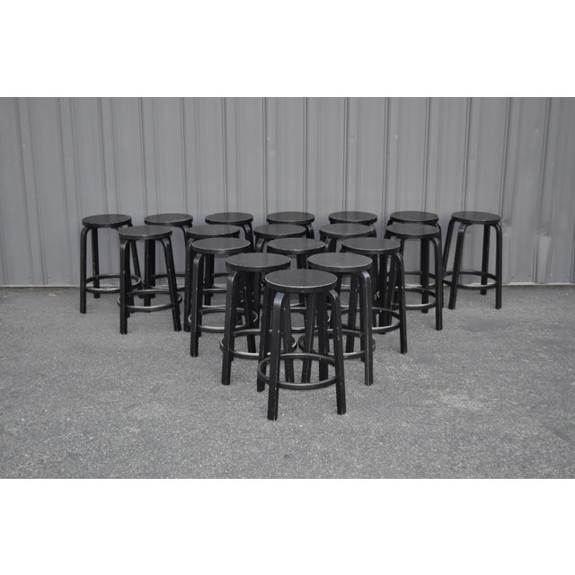 Stools designed by Alvar Aalto for Artek. There are varying degrees of wear as they were purchased for commercial use. 28...
