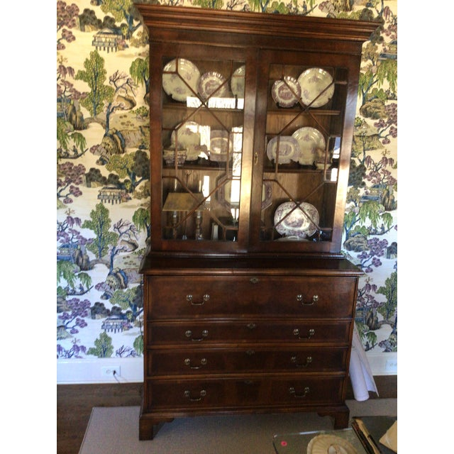 Custom made english breakfront. Made from mahogany with banding and walnut burled lower doors. The bookcase features...