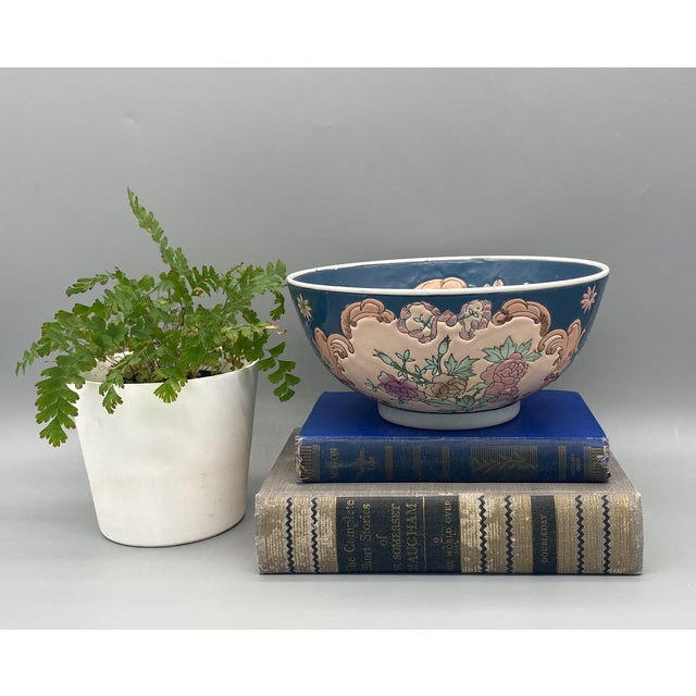 Beautiful Chinese bowl or vide poche. Pink and tan floral pattern outlined by dark blue. Mid to late 20th century piece....