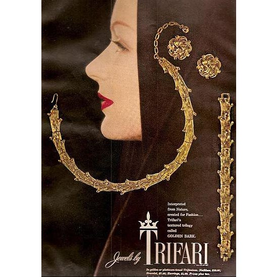 """Goldtone textured """"Golden Bark"""" link bracelet with fold over clasp. Marked: Trifari. Featured in a 1955 advertisement...."""