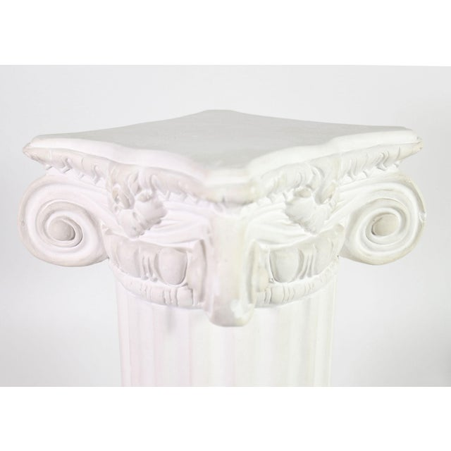 Shown is a vintage solid plaster display pillar in the Greco-Romanesque style of an ionic column, could be used to display...