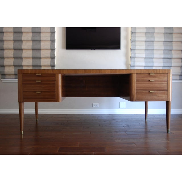 Natural walnut executive desk by Platner & Co. with high-gloss clear resin finish. Black groove detail. Six solid walnut...