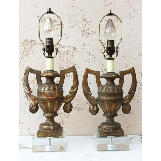 Antique gilded wood vase lamps urn shaped circa 1890 mounted on Lucite bases,rewired for US and working. New shades,...
