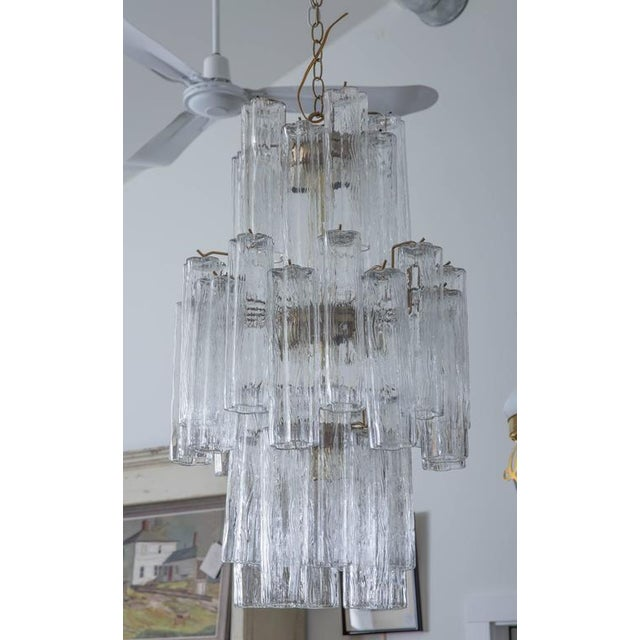 """Handblown Murano glass tube Tronchi, suspended in three tiers. Each tube 10"""" long; 38 total tubes; 11 lights."""
