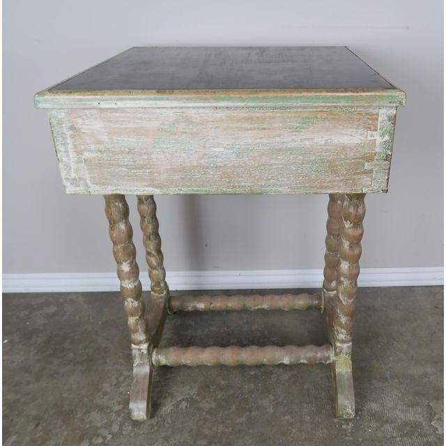 Charming English Checkerboard side table that stands on four turned legs that meet at a center stretcher. Center drawer...