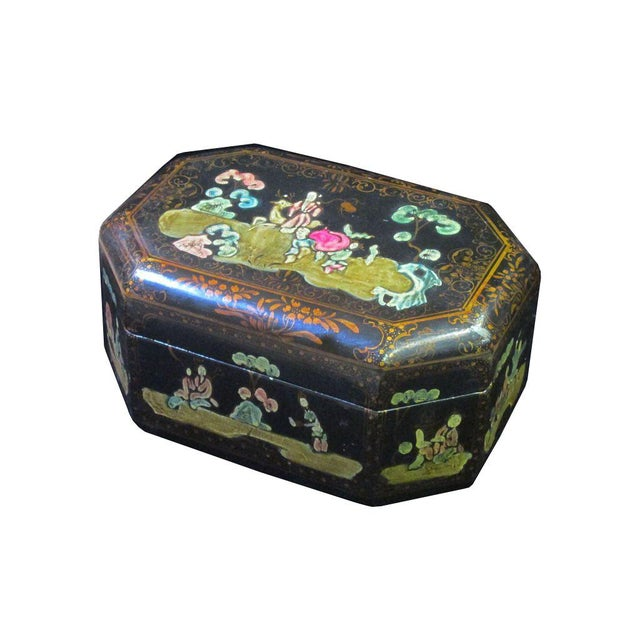 This decorative wooden box is painted with black lacquer on the surface and oriental scenery is precisely drawn on the...